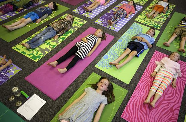 oSummit Cove Elementary School first-graders take a few moments to undergo a body scan mediation exercise inside the classroom May 12, 2017, in Dillon, Colo. The school's special education instructor, Jen Leslie, teaches mindfulness studies once a week in part of a curriculum to improve student self-awareness, empathy and conflict management.