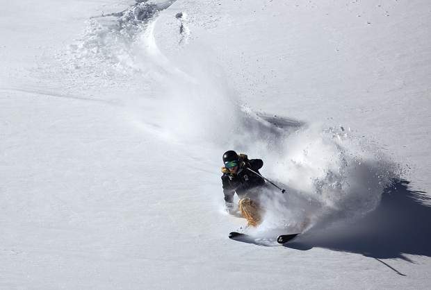 Aspen resident Sam Rittgers takes a few turns on the recent snowfall at Loveland Pass Tuesday, Oct. 3. The nearby ski resort, Arapahoe Basin, received 16 inches of snow in 24 hours by Monday morning.