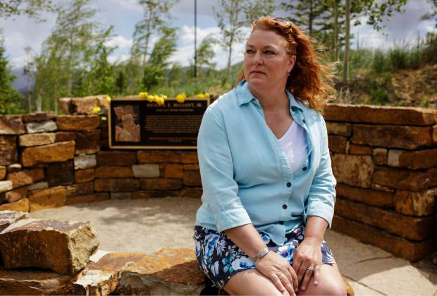 Karen Mahany, widow of Flight For Life's Lifeguard 2 helicopter pilot, Patrick, takes a moment at her husbands memorial following a service to honor the pilot's death two years ago, July 3, 2017, in Frisco, Colo. The helicopter crashed in 2015 shortly after takeoff from the St. Anthony Summit Medical Center in Frisco, with Patrick at the controls, but the two nurses on board survived. Karen Mahany has made federal aviation safety advocacy a primary mission of her life moving forward.