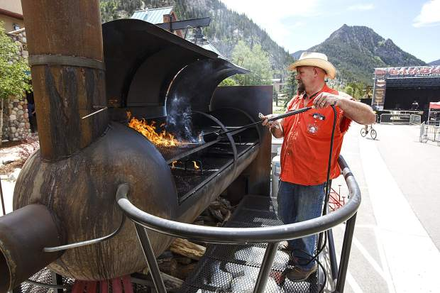 Turkey Crossing BBQ's Jay Spurling, of Hugo, Colo., prepares the smoker with a torch ahead of Colorado BBQ Challenge Thursday June 15, in Frisco. The three-day event will feature over 70 BBQers for the competition, along with pig races, music, kids' activities, and food sampling starting at 11 a.m. today and tomorrow on Main Street.