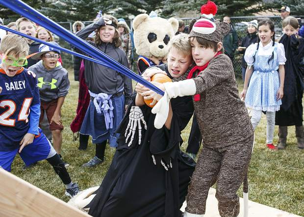 Frisco Elementary School students Anton Pascual, left, and Simon Stevens, right, prepare to launch a pumpkin with a catapult Oct. 27, 2017 in Frisco, Colo. The school was celebrating the STEM program (science, technology, engineering and math) with a pumpkin catapult contest created by each class.