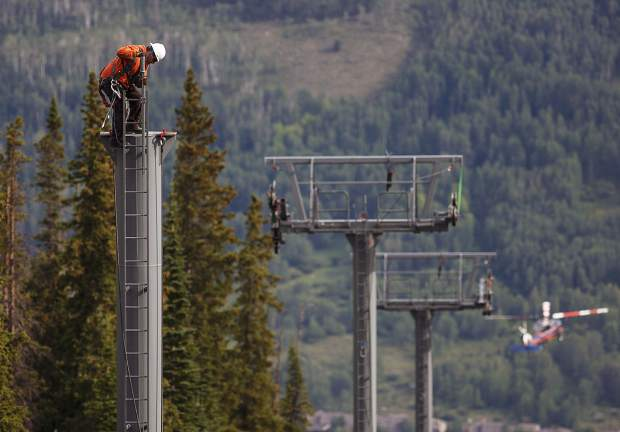 A construction crew member work to replace the existing chairlift towers at Keystone Ski Resort Tuesday, July 11, as part of the construction of the new six-passenger Montezuma Express Lift for the 2017-2018 ski season with help of helicopter operations. The new chairlift will increase the efficiency and capacity up to 25 percent to improve circulation of skiers and snowboarders, according to Keystone Ski Resort.