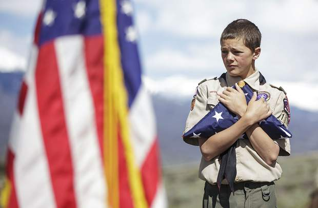 Summit County Boy Scout troop member Dominick Leonardo holds onto the folded flag during the annual Memorial Day of Remembrance Ceremony Monday, May 29, 2017, at the Dillon Cemetery in Dillon, Colo.