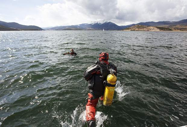 Summit County Dive Rescue diver John Reller jumps into the water for training Sunday, Oct. 1, on the Dillon Reservoir.