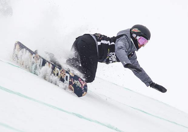 Julia Marino of the United States takes a fall in the slopestyle finals during the Dew Tour event Saturday, Dec. 16 at Breckenridge Ski Resort.