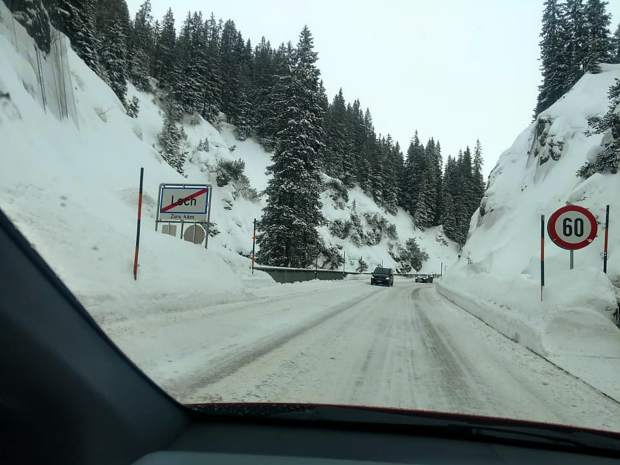 The Swaims drive through the snow as they depart Lech, Austria.
