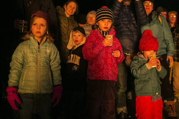 Children watch the Spontaneous Combustion bonfire Saturday, Jan. 20, at the Frisco Marina.