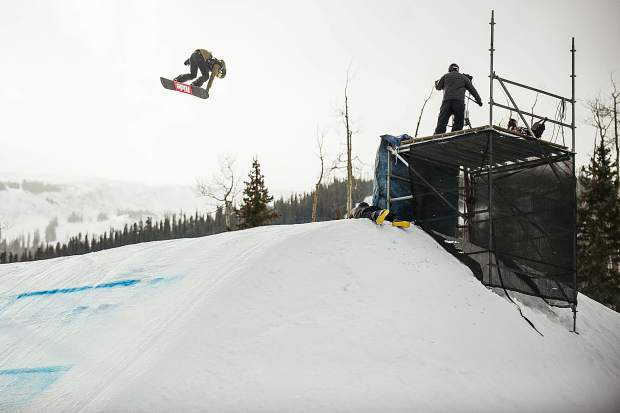 Jessika Jenson of the United States hits a jump on the slopestyle course during her second run in the women's snowboard slopestyle qualifiers at Snowmass for the U.S. Grand Prix on Wednesday. Jenson ranked first in the qualifiers.