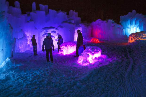Visitors check out the Ice Castles at the Dillon Town Park Tuesday night in Dillon. The handcrafted Ice Castles opens today at 4 p.m. with the entrance from Buffalo Street in Dillon.