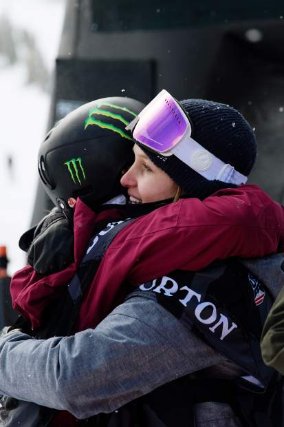 Julia Marino and Jamie Anderson hug after Anderson won Saturday's snowboard slopestyle U.S. Grand Prix event at Mammoth Mountain in California. Marino took second, a performance that clinched her first trip to the Olympic games for Team USA next month in Pyeongchang, South Korea.