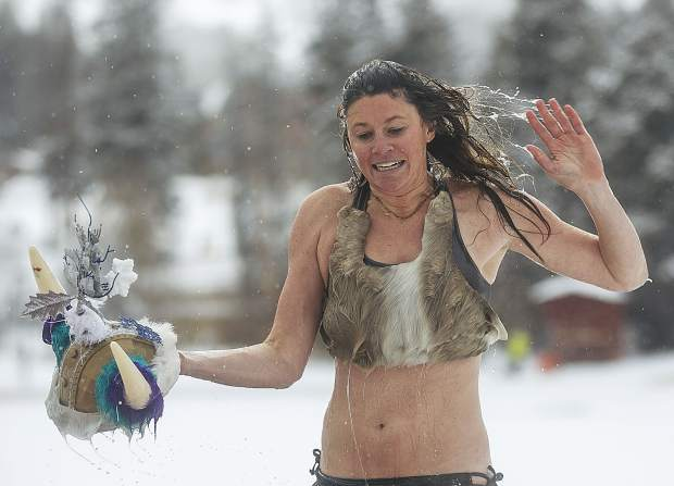 A participant walks towards the hot tub following a dip in the Maggie Pond for the Ullr Ice Plunge Friday, Jan. 12, in Breckenridge.