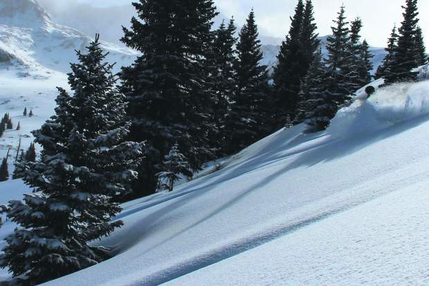 A skier rides powder on Sunday after a fresh 5 inches on Saturday night.