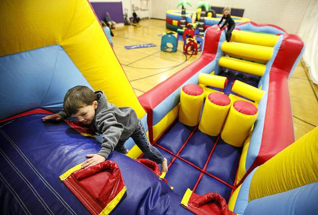 Ben Schappert explores the bounce house at the Breckenridge Recreation Center Friday, Jan. 12, in Breckenridge.