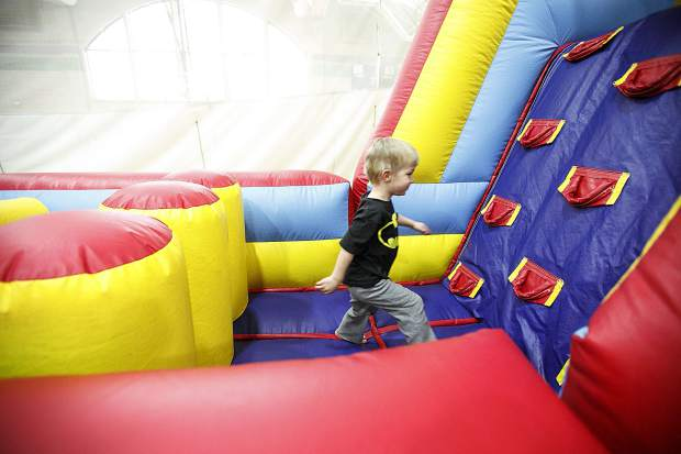 Liam Oderman, 3, explores the bounce house at the Breckenridge Recreation Center Friday, Jan. 12, in Breckenridge.