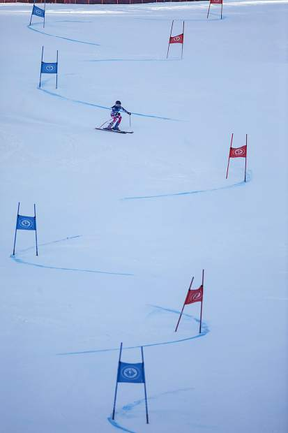 A competitor races down the hill in the SYNC Ski-Up giant Slalom Thursday, Jan. 4, at Loveland Ski Area.