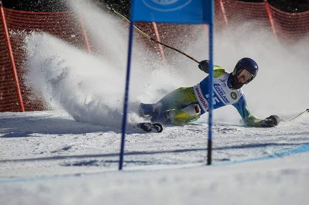 Henry Strauch slips while competing in the SYNC Ski-Up giant Slalom Race Thursday, Jan. 4, at Loveland Ski Area.