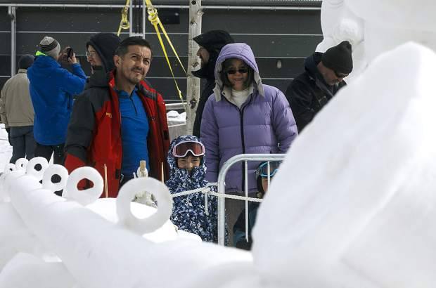 Visitors check out the masterpieces during the International Snow Sculpture Championships Friday, Jan. 26, next to the Riverwalk Center in Breckenridge.