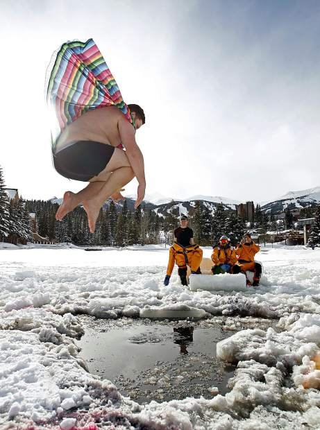 A man leaps into Maggie Pond in Breckenridge for the Ullr Ice Plunge, one of a number of events tied into the annual Ullr Fest celebration in Breckenridge. The festival that pays tribute to the Norse snow god is headed into its 55th year and goes from Wednesday-Saturday. The plunge will be from 2-4 p.m. Friday.