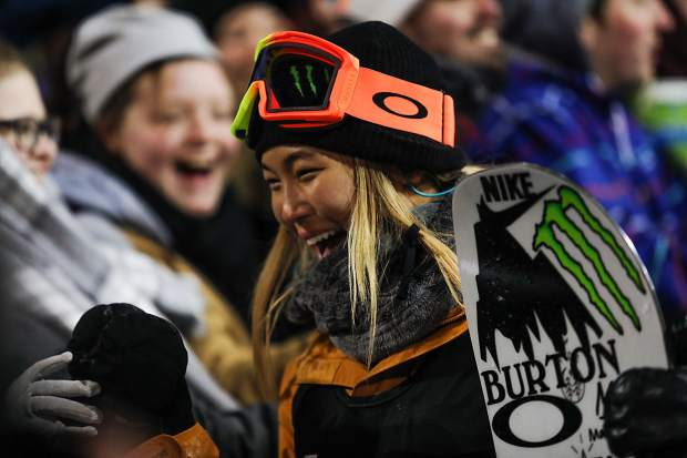 Chloe Kim on her third run competing in the women's snowboard superpipe finals on Saturday night at Buttermilk. Kim took first place from her third run score of 93.33.
