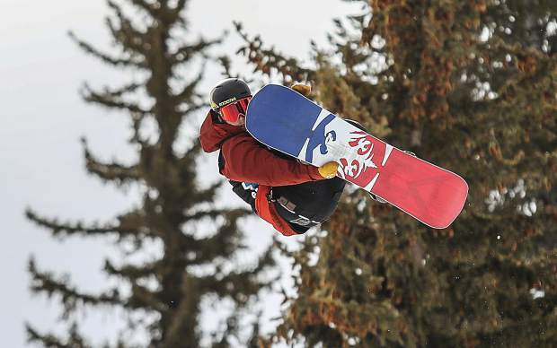 Chris Corning goes for a grab during the slopestyle qualifiers at X Games Aspen on Thursday at Buttermilk Mountain.