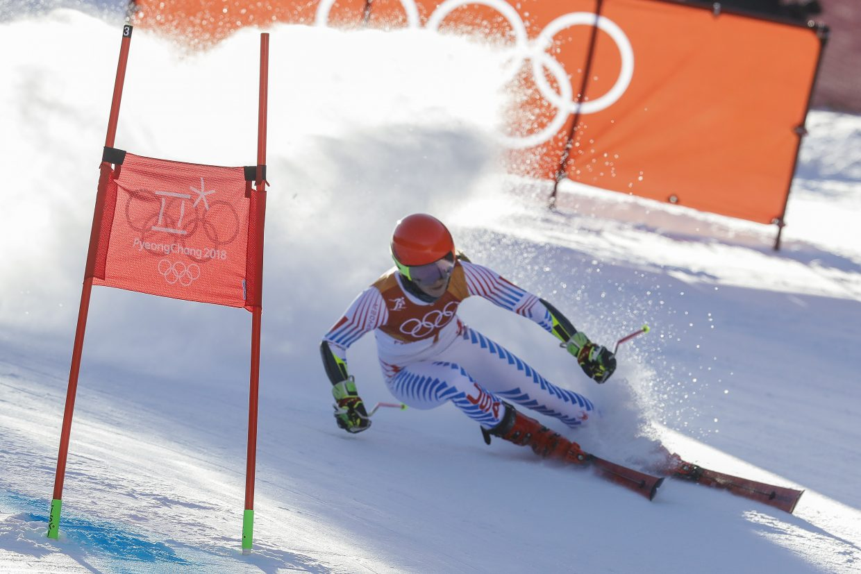 Mikaela Shiffrin, of the United States, attacks the gate during the first run of the Women's Giant Slalom at the 2018 Winter Olympics in Pyeongchang, South Korea, Thursday, Feb. 15, 2018., Thursday, Feb. 15, 2018. (AP Photo/Michael Probst)