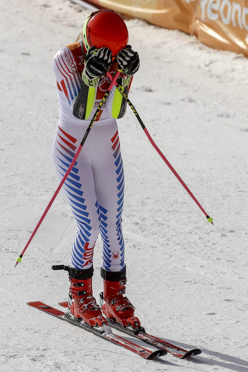 Mikaela Shiffrin, of the United States, holds her head in her hands after winning the gold medal in the Women's Giant Slalom at the 2018 Winter Olympics in Pyeongchang, South Korea, Thursday, Feb. 15, 2018. (AP Photo/Morry Gash)