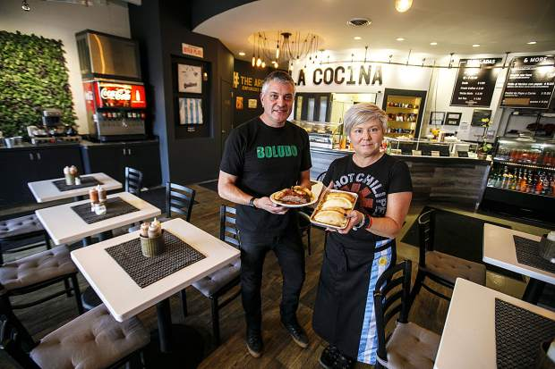 Owners of The Argentos Empanadas & More, Leo, left, and Andrea Tartufoli, from Argentina, at their restaurant Friday, Feb. 23, in Silverthorne.