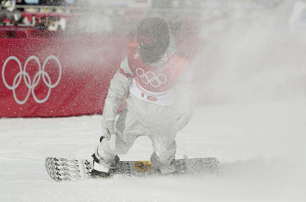 Kyle Mack, of the United States, lands during the men's Big Air snowboard qualification competition at the 2018 Winter Olympics in Pyeongchang, South Korea, Wednesday, Feb. 21, 2018. (AP Photo/Kirsty Wigglesworth)
