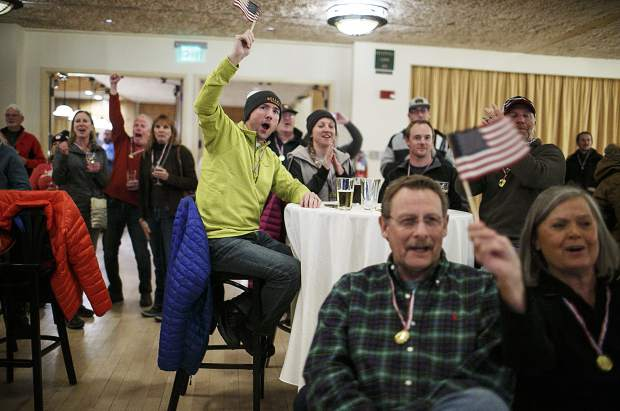 Local residents cheer on Olympians from Silverthorne competing in the Snowboard Big Air competition at the Winter Olympics in South Korea while watching the live steam from the Silverthorne Pavilion Tuesday, Feb. 20.