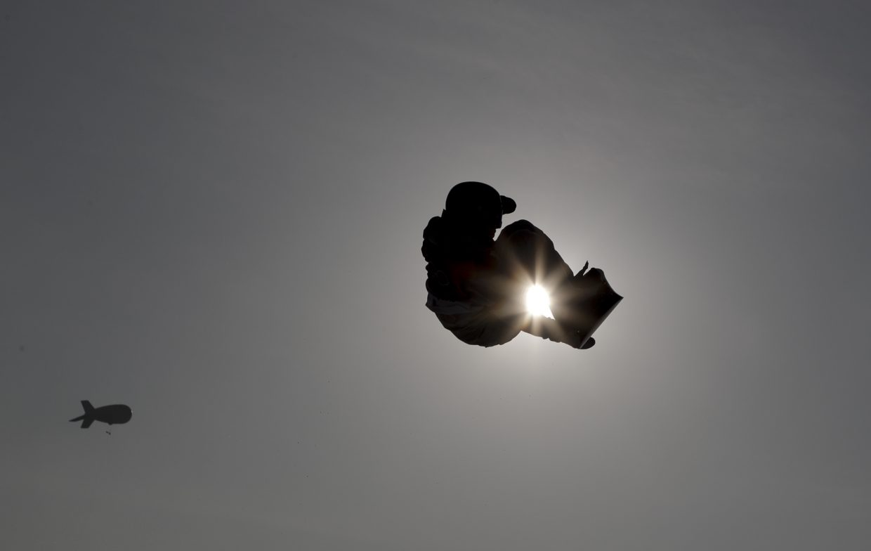 Chris Corning, of the United States, jumps training for during the men's Big Air snowboard competition at the 2018 Winter Olympics in Pyeongchang, South Korea, Saturday, Feb. 24, 2018. (AP Photo/Matthias Schrader)