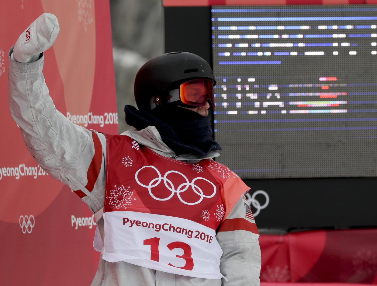 Kyle Mack, of the United States, reacts after his jump during the men's Big Air snowboard competition at the 2018 Winter Olympics in Pyeongchang, South Korea, Saturday, Feb. 24, 2018. (AP Photo/Kirsty Wigglesworth)