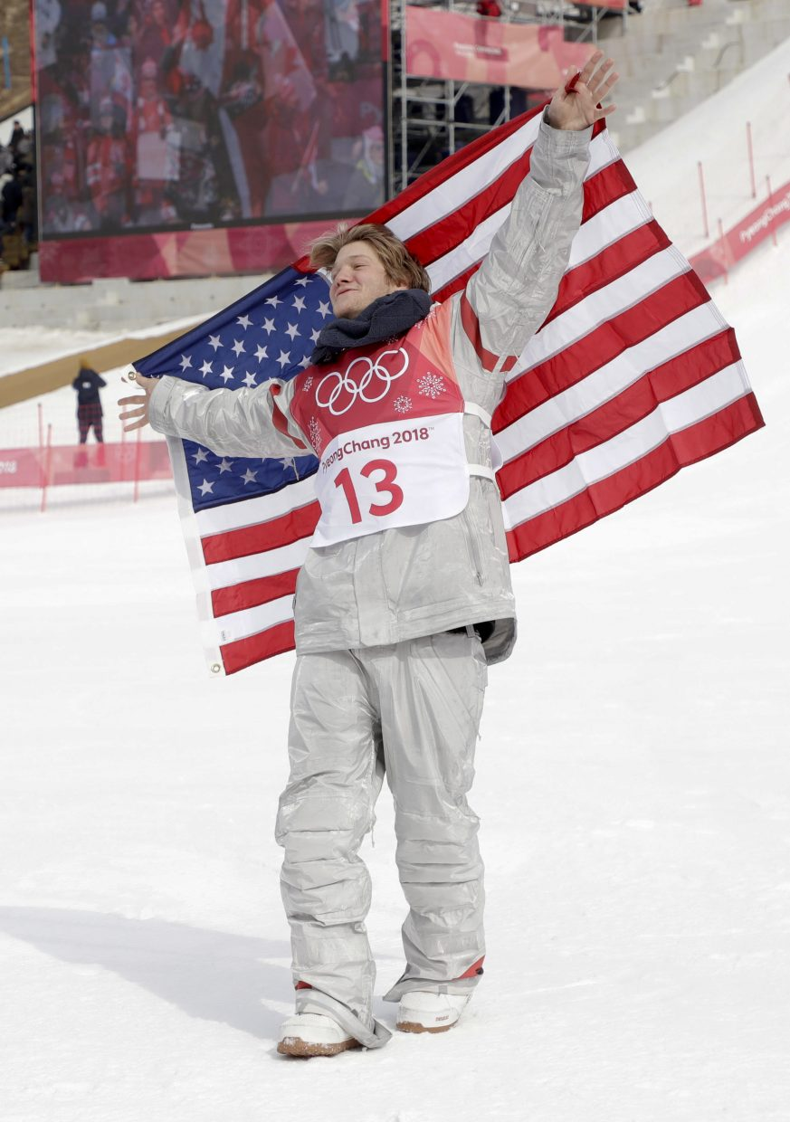 Kyle Mack, of the United States, celebrates after winning the silver medal in the men's Big Air snowboard competition at the 2018 Winter Olympics in Pyeongchang, South Korea, Saturday, Feb. 24, 2018. (AP Photo/Matthias Schrader)