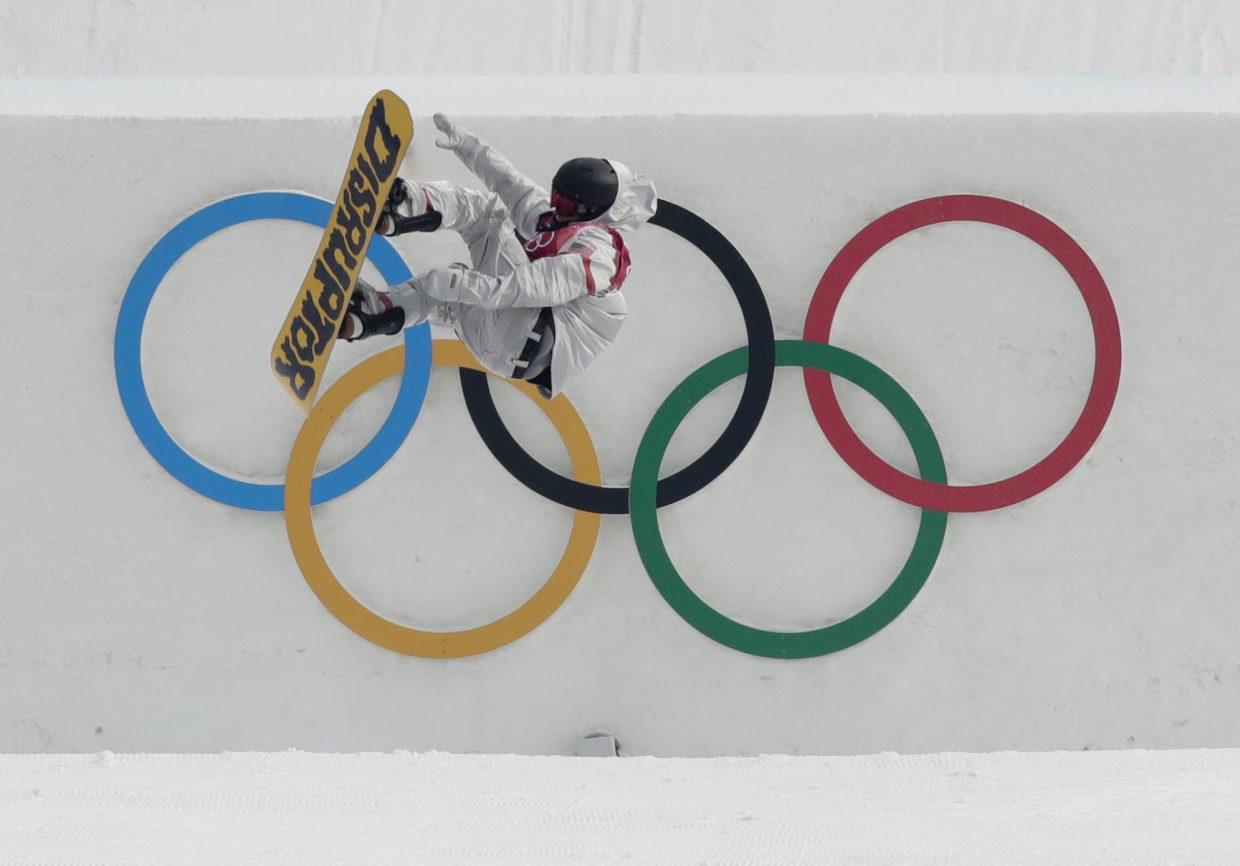 Kyle Mack, of the United States, jumps during training for the men's Big Air snowboard competition at the 2018 Winter Olympics in Pyeongchang, South Korea, Saturday, Feb. 24, 2018. (AP Photo/Dmitri Lovetsky)