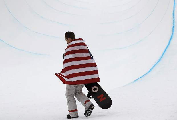 Gold medal winner Shaun White, of the United States, celebrates after finishing his run during the men's halfpipe finals at Phoenix Snow Park at the 2018 Winter Olympics in Pyeongchang, South Korea, Wednesday, Feb. 14, 2018.