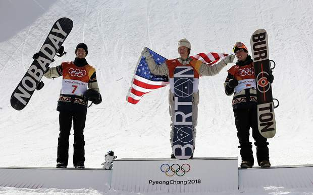 From left: Silver medal winner Max Parrot, of Canada (7), gold medal winner Red Gerard, of the United States (6), and Bronze medal winner Mark McMorris, of Canada, cheer during the medal recognition ceremony after the men's slopestyle final at Phoenix Snow Park at the 2018 Winter Olympics in Pyeongchang, South Korea, Sunday, Feb. 11, 2018.