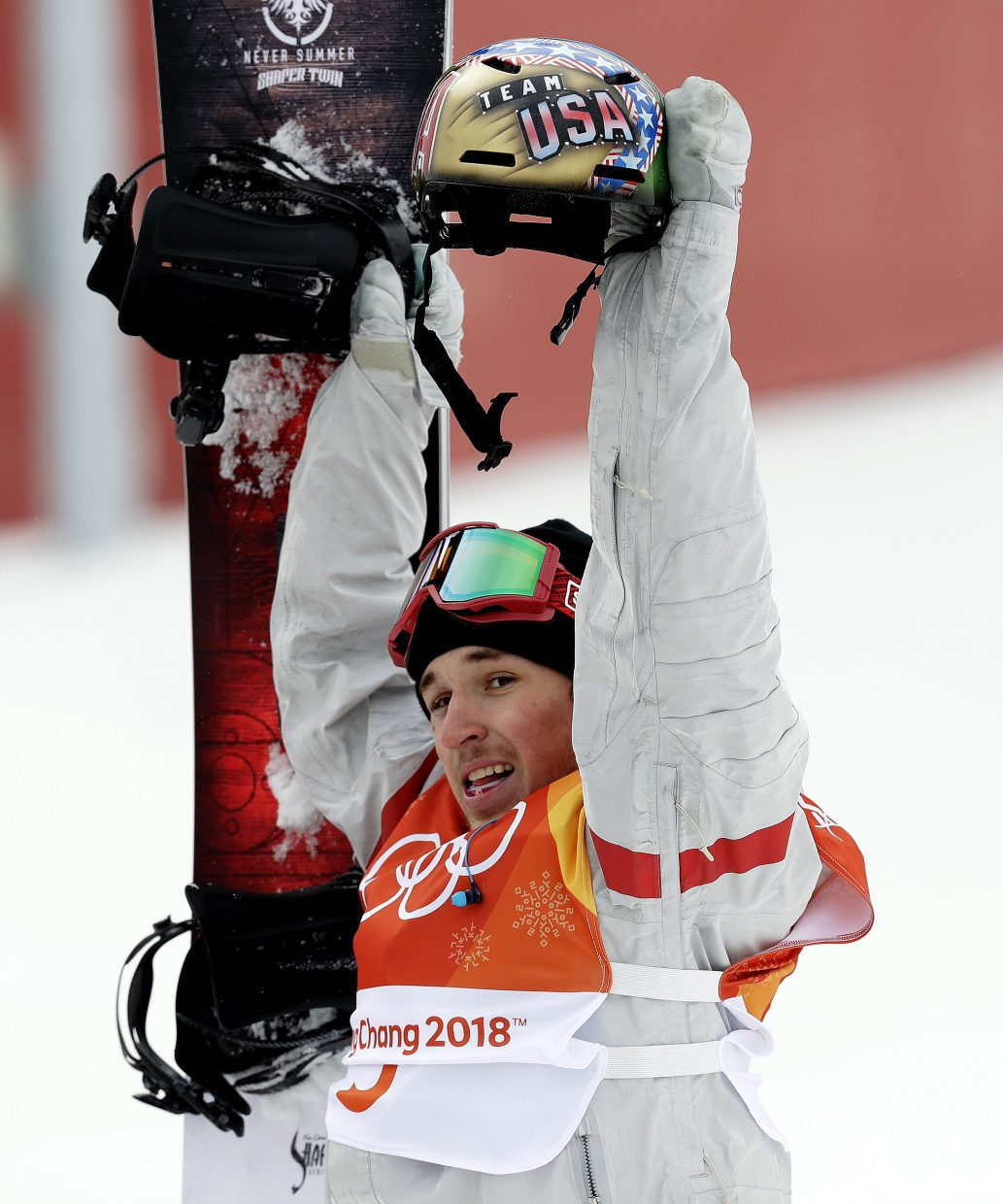 Chris Corning, of the United States, waves to the crowd after his run during the men's slopestyle qualifying at Phoenix Snow Park at the 2018 Winter Olympics in Pyeongchang, South Korea, Saturday, Feb. 10, 2018. (AP Photo/Kin Cheung)