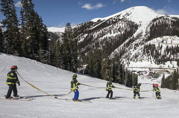 City firefighters from the Red, White, and Blue Fire Department ski on the course of 15 slalom gates during 12th annual Fire Hose Relay Race Friday, Feb. 23, at Arapahoe Basin Ski Area.
