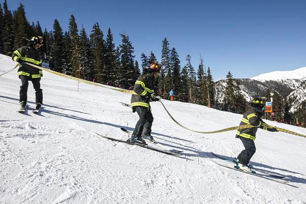 Red, White, and Blue Fire Department's team of five firefighters take off for the slalom gates in the 12th annual Fire Hose Relay Race Friday, Feb. 23, at Arapahoe Basin Ski Area.