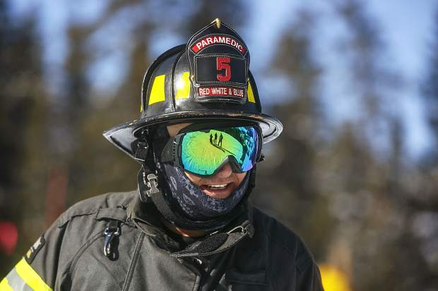 Red, White, and Blue firefighter smiles while participating in the 12th annual Fire Hose Relay Race Friday, Feb. 23, at Arapahoe Basin Ski Area.