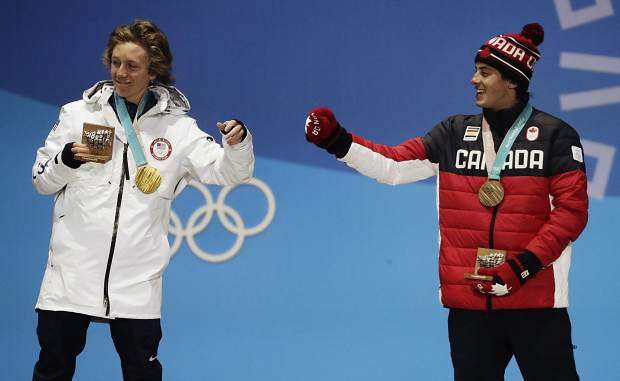 Men's slopestyle gold medalist Red Gerard, of the United States, left, and bronze medalist Mark McMorris, of Canada, celebrate during the medals ceremony at the 2018 Winter Olympics in Pyeongchang, South Korea, Sunday, Feb. 11, 2018.