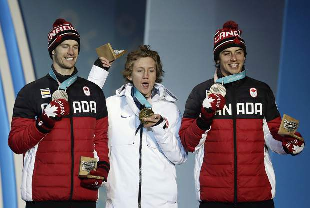 Men's slopestyle medalists, from left, Canada's Max Parrot, silver, United States's Red Gerard, gold, and Canada'ss Mark McMorris, bronze, pose during their medals ceremony at the 2018 Winter Olympics in Pyeongchang, South Korea on Sunday, Feb. 11, 2018.