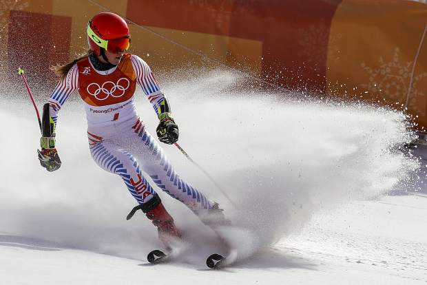 Mikaela Shiffrin, of the United States, skies into the finish area after winning the gold medal in the Women's Giant Slalom at the 2018 Winter Olympics in Pyeongchang, South Korea on Thursday Feb. 15.