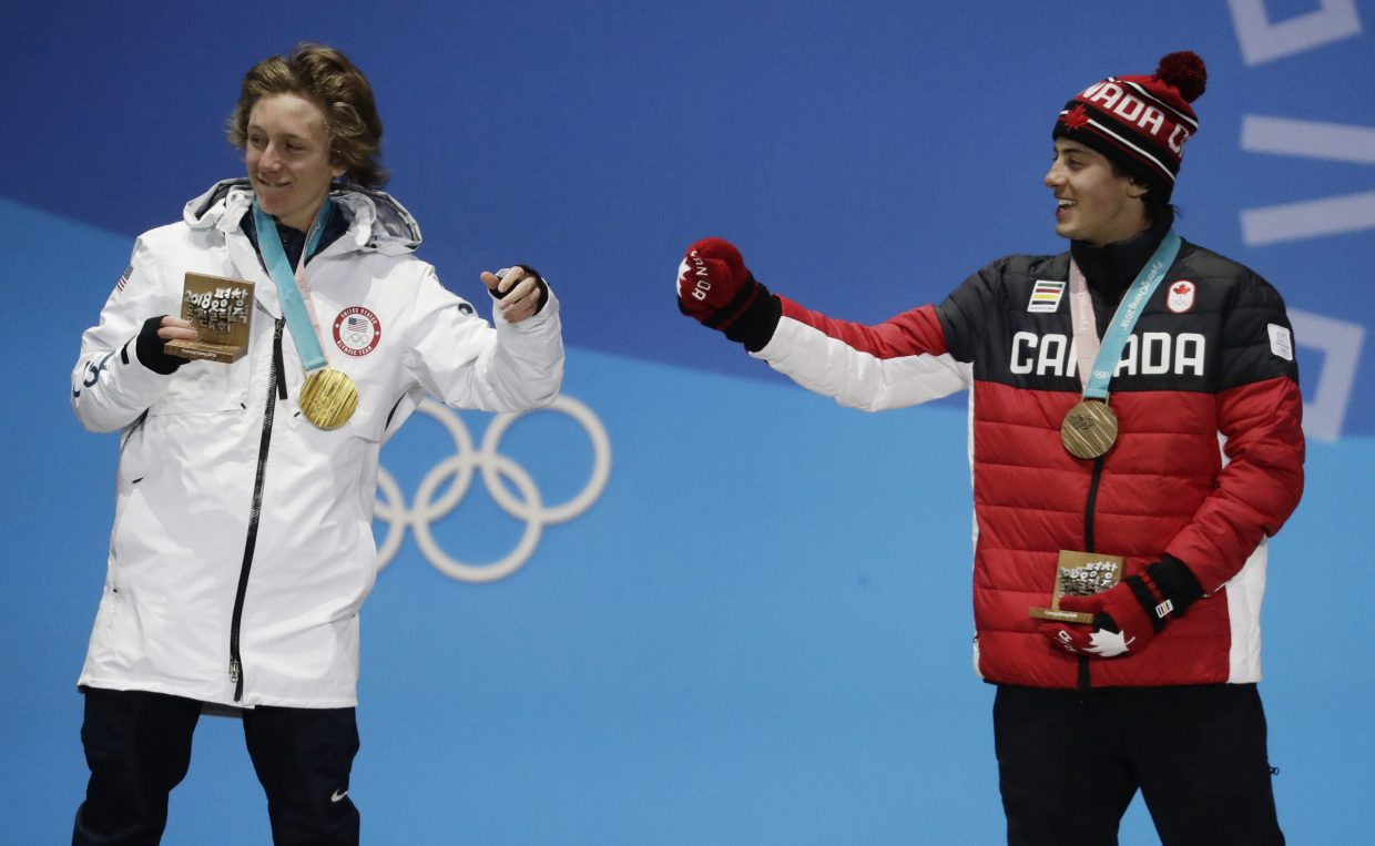Men's slopestyle gold medalist Red Gerard, of the United States, left, and bronze medalist Mark McMorris, of Canada, celebrate during the medals ceremony at the 2018 Winter Olympics in Pyeongchang, South Korea, Sunday, Feb. 11, 2018. (AP Photo/Morry Gash)