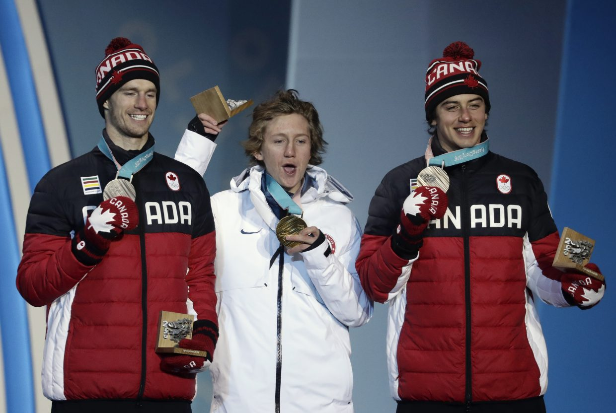 Men's slopestyle medalists, from left, Canada's Max Parrot, silver, United States' Red Gerard, gold, and Canada's Mark McMorris, bronze, pose during their medals ceremony at the 2018 Winter Olympics in Pyeongchang, South Korea, Sunday, Feb. 11, 2018. (AP Photo/Morry Gash)