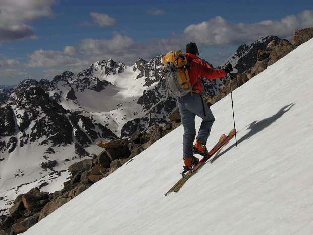 Art Burrows begins an early morning skin up toward Mount Powell in the Gore Range.