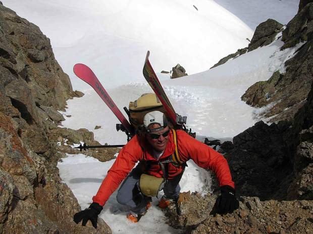 Climbing up through the Gore Range's Atlas Notch in late spring, in pursuit of ski lines.