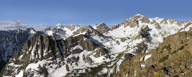 A panoramic photo taken during a late spring morning at the Dora Plateau in the Gore Range.