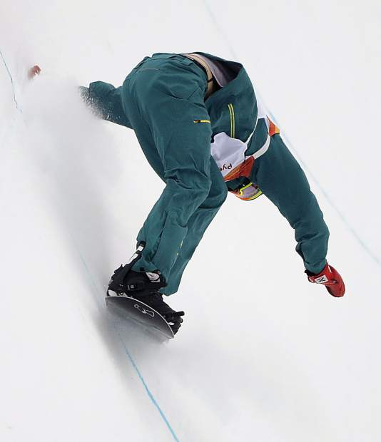 Scotty James, of Australia, keeps his balance during the men's halfpipe finals at Phoenix Snow Park at the 2018 Winter Olympics in Pyeongchang, South Korea, Wednesday, Feb. 14, 2018. (AP Photo/Gregory Bull)