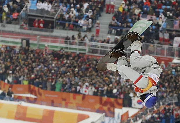 Ben Ferguson, of the United States, jumps during the men's halfpipe finals at Phoenix Snow Park at the 2018 Winter Olympics in Pyeongchang, South Korea, Wednesday, Feb. 14, 2018. (AP Photo/Kin Cheung)