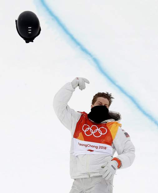 Shaun White, of the United States, tosses his helmet as he celebrates after his run during the men's halfpipe finals at Phoenix Snow Park at the 2018 Winter Olympics in Pyeongchang, South Korea, Wednesday, Feb. 14, 2018. (AP Photo/Gregory Bull)